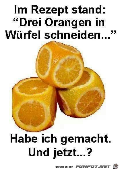 drei Orangen in Wuerfel schneiden