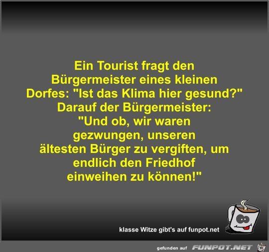 Ein Tourist fragt den Bürgermeister eines kleinen Dorfes