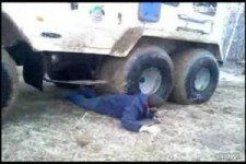 russian guy gets stuck under tire truck WMV V9